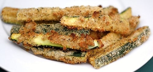 pile of healthy baked Zucchini fries on plate