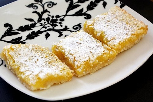 Lemon squares in a row on serving dish