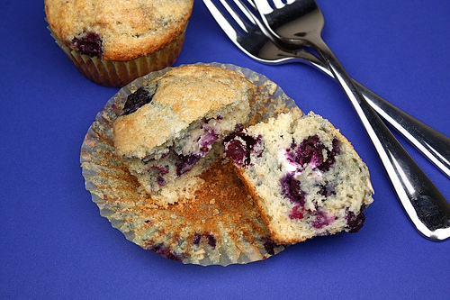 Blueberry Lemon Cream Cheese Muffins on twopeasandtheirpod.com Love the surprise cream cheese filling!