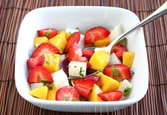 Strawberry Mango Salad Recipe on twopeasandtheirpod.com This simple and healthy salad is perfect for summertime!