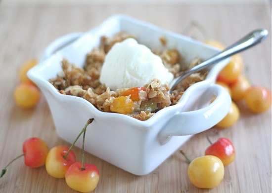 rhubarb crisp with cherries and topped with vanilla ice cream