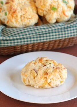 Cheddar biscuits with bacon and onion on plate and in basket