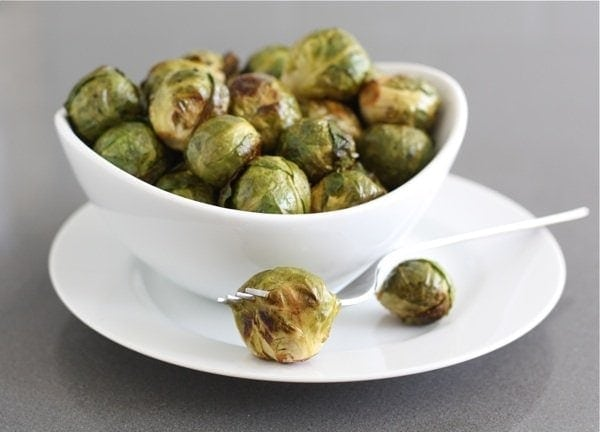 Roasted Brussels Sprouts in white serving bowl