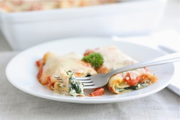 cannelloni with spinach, mushrooms and cheese on fork