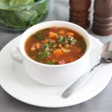 sweet potato lentil soup in soup bowl with spoon
