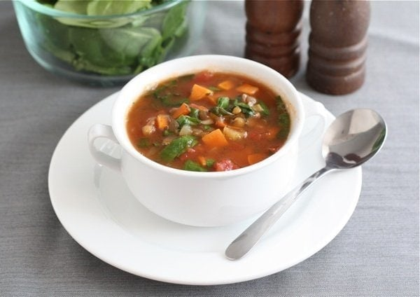 Lentil soup with spinach and sweet potatoes in bowl