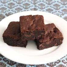 Three fudge brownies on plate made from best Brownie recipe