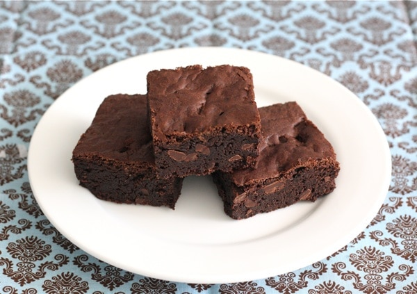 Three fudge brownies on plate made from easy brownie recipe