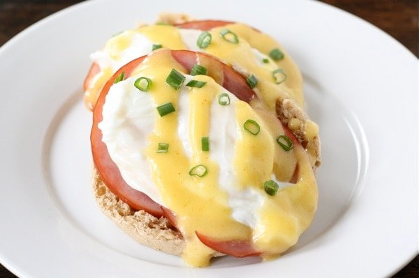 Eggs Benedict on plate with hollandaise sauce