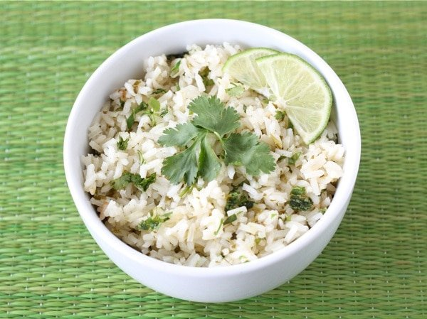 cilantro lime rice with lime and parsley on top