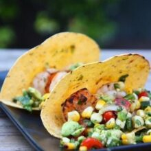 shrimp tacos served with grilled vegetable salsa