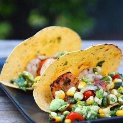 shrimp tacos served with grilled vegetable salsa