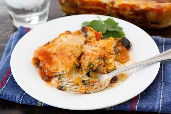 Stacked Roasted Vegetable Enchilada Recipe on twopeasndtheirpod.com #recipe