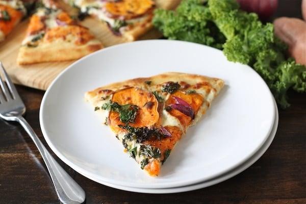 Sweet Potato Kale Pizza Recipe on twopeasandtheirpod.com #recipe
