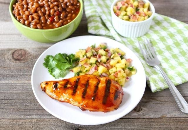Bbq chicken with pineapple bacon salsa recipe two peas for What sides go with barbecue chicken