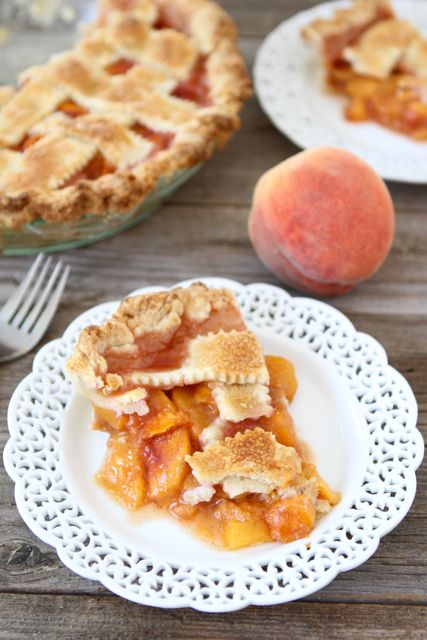 Peach pie slice with peach pie filling on plate