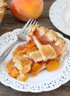 Peach pie slice on white plate