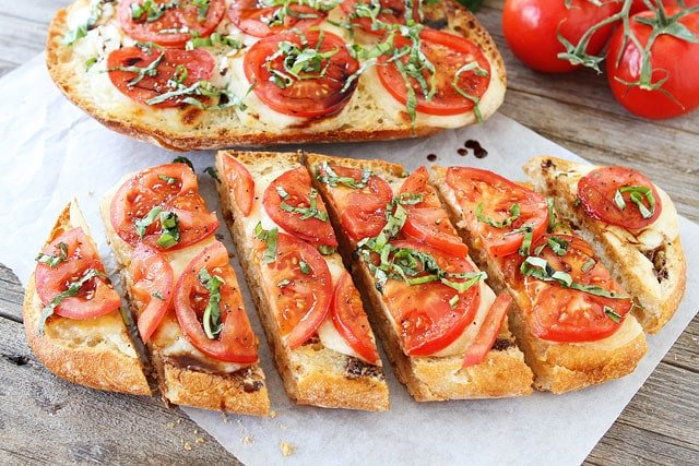 Caprese Garlic Bread is a family favorite recipe and perfect for summertime.