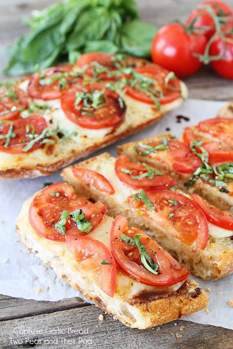 Caprese Garlic Bread is garlic bread with fresh mozzarella cheese, tomatoes, basil, and balsamic glaze. It is the best garlic bread recipe!