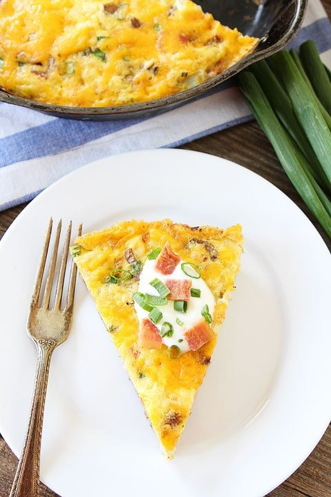 Potato Frittata slice with sour cream and onions on top