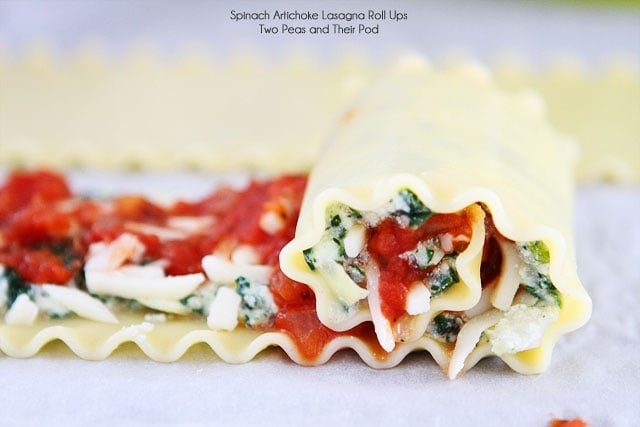 Easy Spinach Artichoke Lasagna Roll Ups on twopeasandtheirpod.com Fun to make and fun to eat!