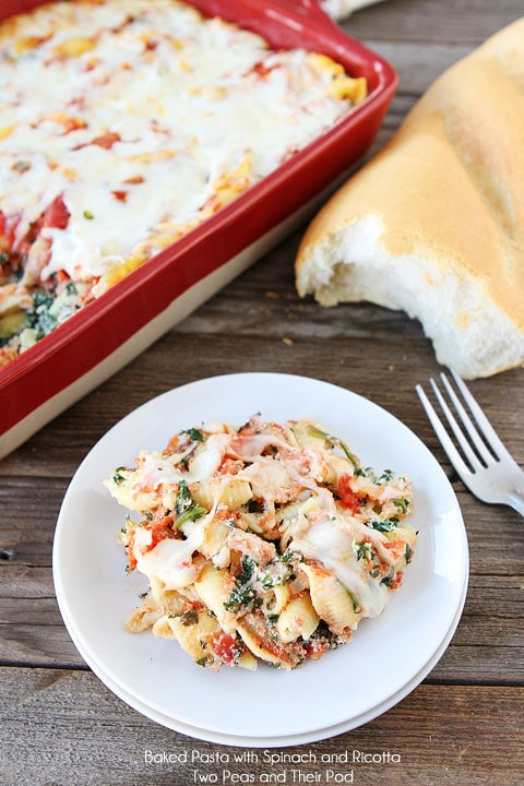 Baked spinach pasta shells served with french bread