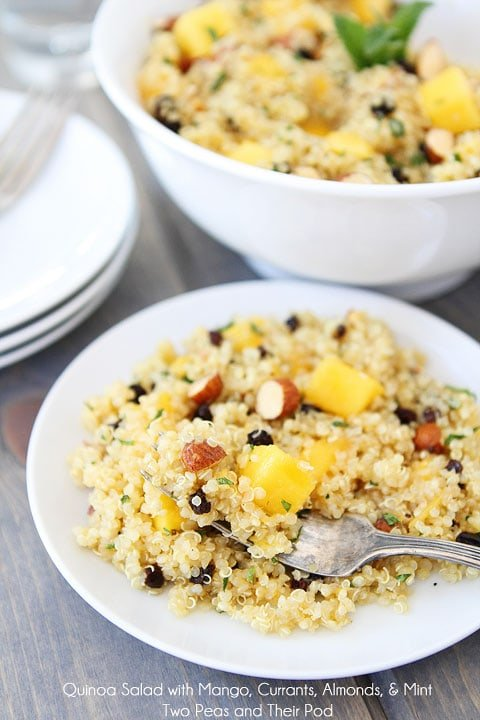 Quinoa Salad with Mango, Currants, Almonds, & Mint Recipe on twopeasandtheirpod.com This gluten-free and vegan salad is simple to make and so delicious!
