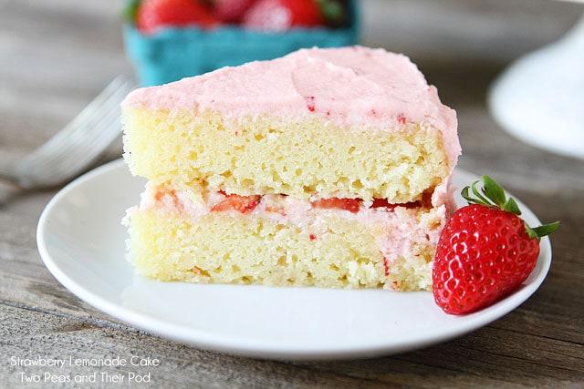 Strawberry Lemonade Cake Recipe on twopeasandtheirpod.com Tart lemon cake with fresh strawberries and strawberry buttercream!