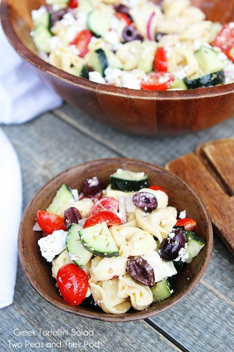 Greek Tortellini Salad served in wooden bowl