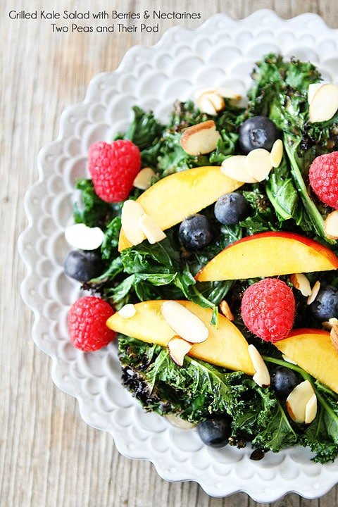 Grilled Kale Salad with Berries & Nectarines Recipe on twopeasandtheirpod.com A must make salad for summer!