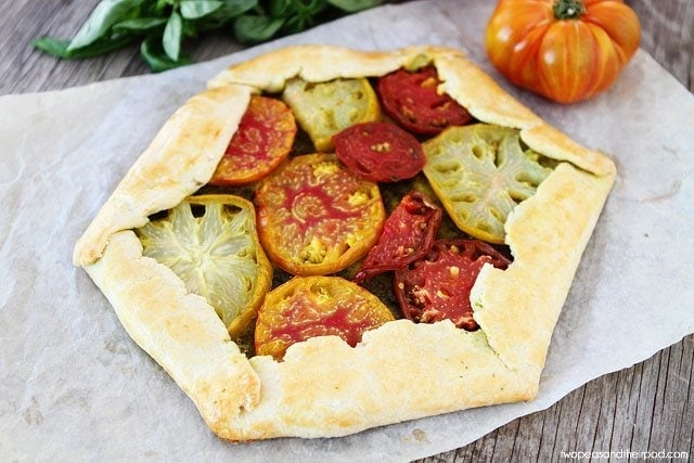Beautiful Heirloom Tomato Pesto Galette on twopeasandtheirpod.com