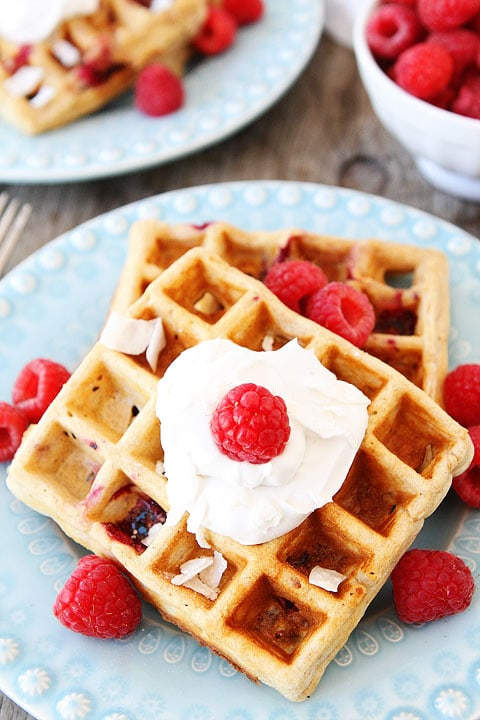 Coconut Raspberry Waffles with Coconut Whipped Cream Recipe on twopeasandtheirpod.com Our favorite waffles!