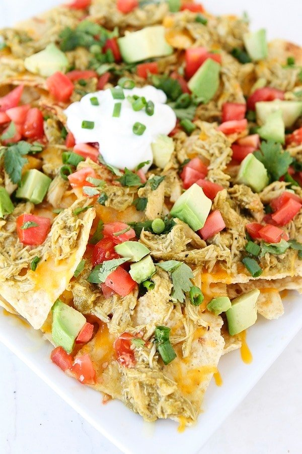 Chicken Chile Verde Nachos Recipe on twopeasandtheirpod.com Perfect for game day!