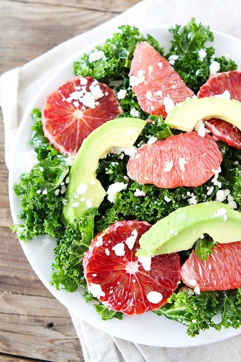 Kale Salad with Citrus, Avocado, and Feta on twopeasandtheirpod.com Love this healthy and simple salad!