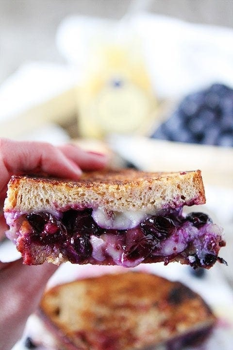 Blueberry, Brie and Lemon Curd Grilled Cheese Recipe on twopeasandtheirpod.com The BEST grilled cheese I've ever tasted!