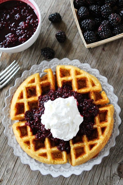Cornmeal Waffles with Blackberry Compote Recipe on twopeasandtheirpod.com. A great way to start any day! This waffle recipe is SO good!