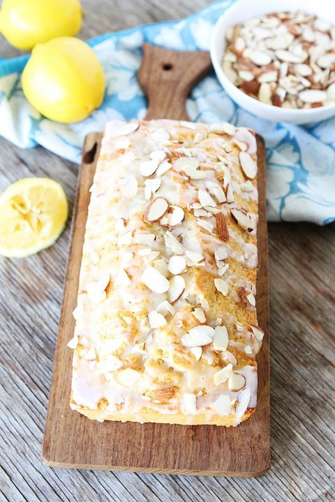 Lemon Almond Bread with a sweet lemon glaze and sliced almonds. This easy lemon quick bread recipe is a family favorite!