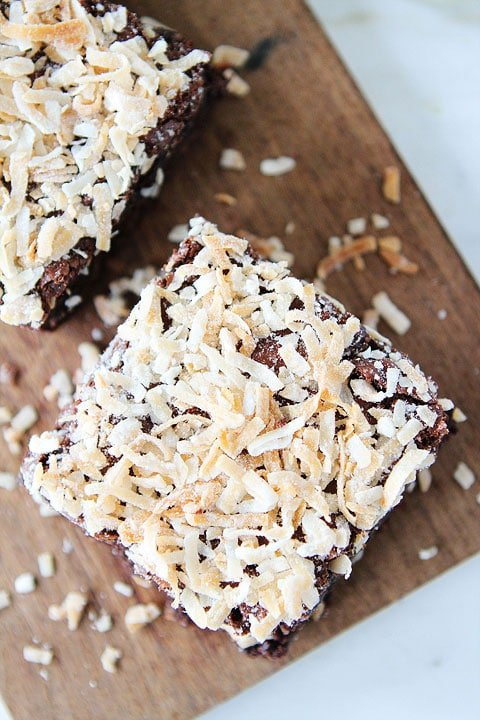 Coconut Brownie Recipe on twopeasandtheirpod.com. Fudgy brownies topped with coconut! Love these rich brownies!