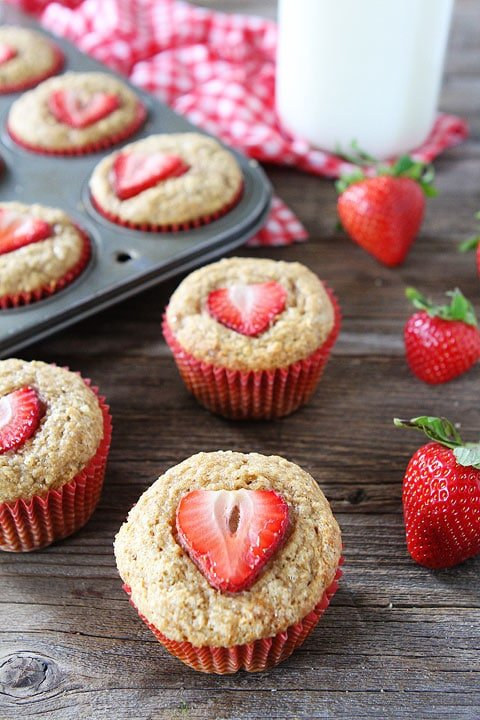 banana muffins with strawberry slices on top
