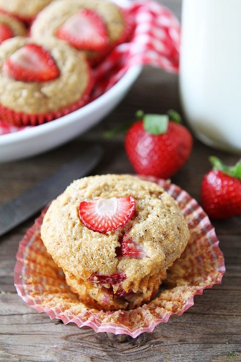 Strawberry Banana Muffins served with glass of milk