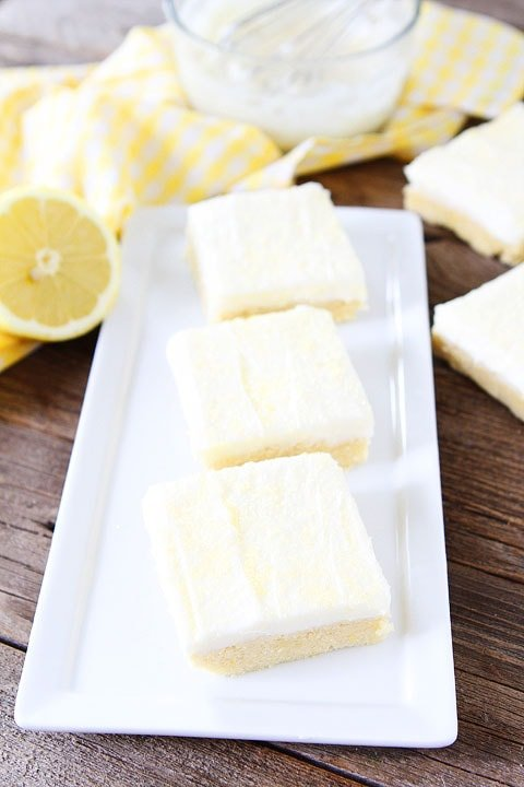 Lemon Sugar Cookie Bars Recipe on twopeasandtheirpod.com. Perfect bars for entertaining! Love the lemon cream cheese frosting! #lemon #dessert