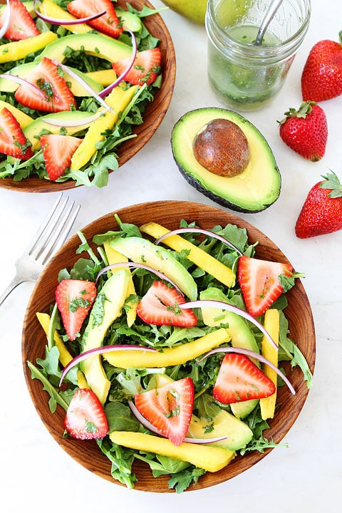 Mango, Strawberry, and Avocado Arugula Salad Recipe on twopeasandtheirpod.com. This gorgeous salad is simple to make and perfect for summer! #salad