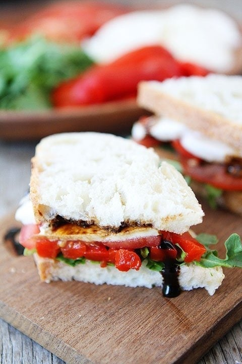 Roasted Red Pepper, Arugula, and Mozzarella Sandwich Recipe on twopeasandtheirpod.com. This simple sandwich is great for lunch or dinner! #sandwich #vegetarian