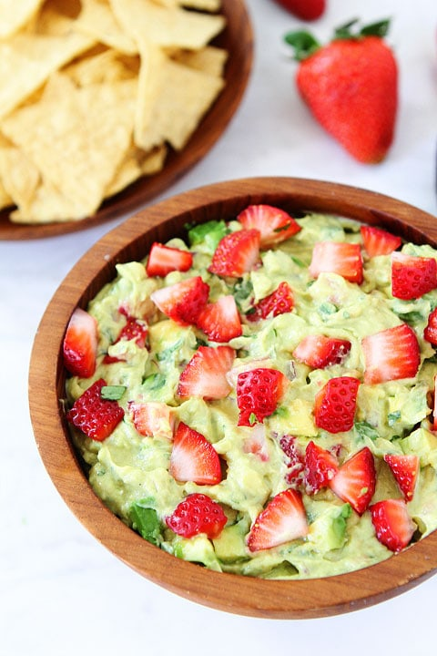 Strawberry Goat Cheese Guacamole Recipe on twopeasandtheirpod.com. Love this creamy and fruity guacamole! #avocado #glutenfree