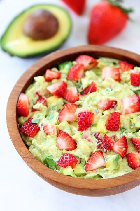 Strawberry Goat Cheese Guacamole Recipe on twopeasandtheirpod.com. Love this creamy and fruity guacamole! #avocado #appetizer #guacamole