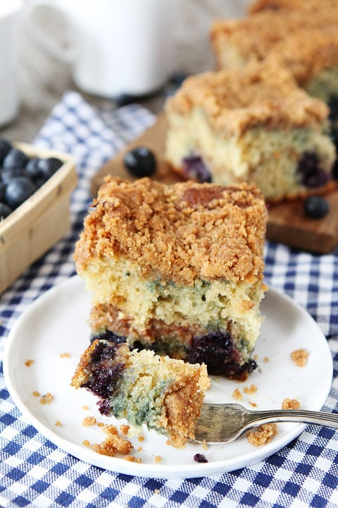 Eating Blueberry Coffee Cake With Fork