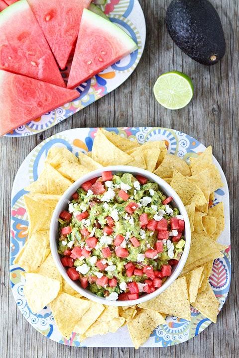 Watermelon Feta Guacamole Recipe on twopeasandtheirpod.com. The perfect guacamoel for summer! #glutenfree #summer