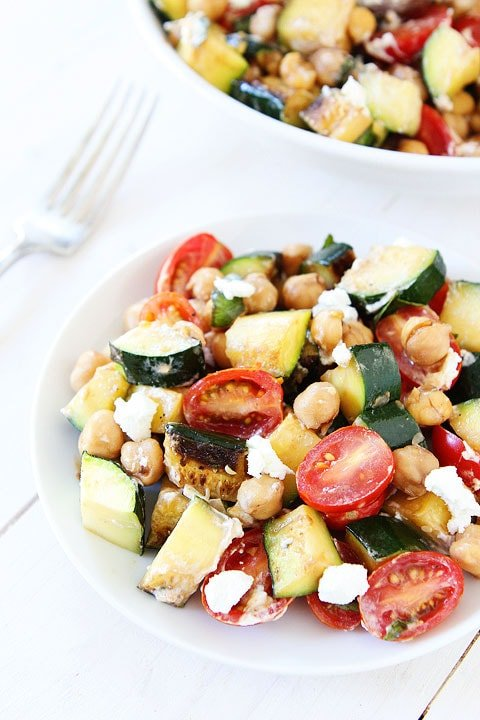 Grilled Zucchini, Chickpea, Tomato, and Goat Cheese Salad Recipe on twopeasandtheirpod.com A great way to use up the summer zucchini!