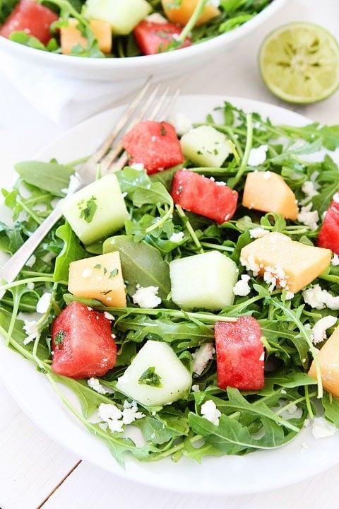 Melon Arugula Salad with Honey Lime Dressing Recipe on twopeasandtheirpod.com #salad #recipe #glutenfree