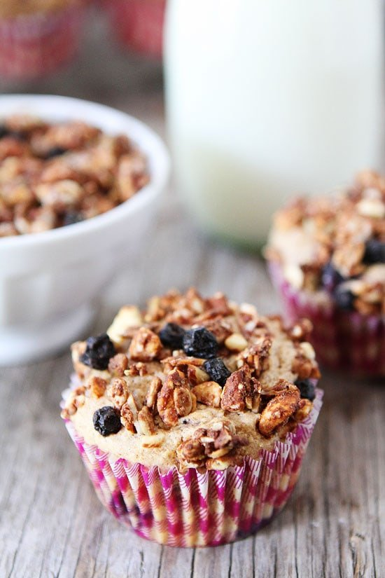 Whole Wheat Mixed Berry Granola Muffins Recipe on twopeasandtheirpod.com Love this easy and healthy muffin recipe!